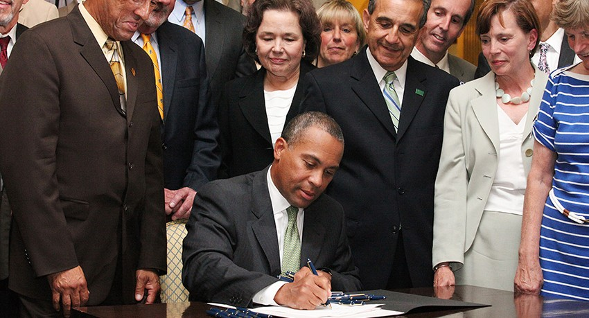 Governor Deval Patrick signs university status bill
