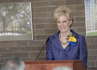 Worcester State University alumna Jill Dagilis speaks at the Scholarship Tea.