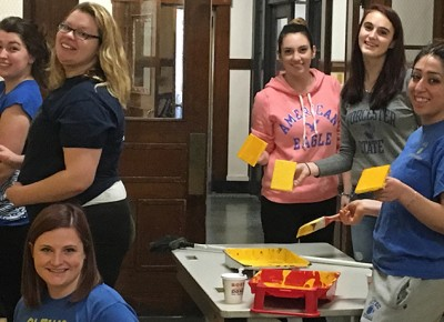 Worcester State University students paint May Street School