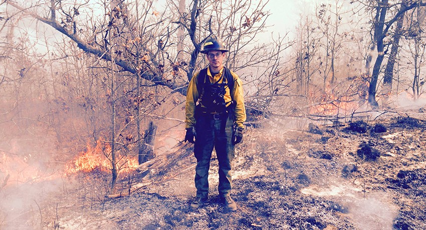 Worcester State University biology major Jesse Caney on the scene of a wildland fire