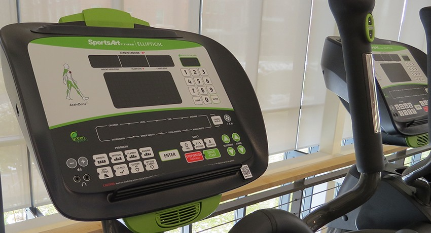 A green ellipical machine in Worcester State University's Wellness Center
