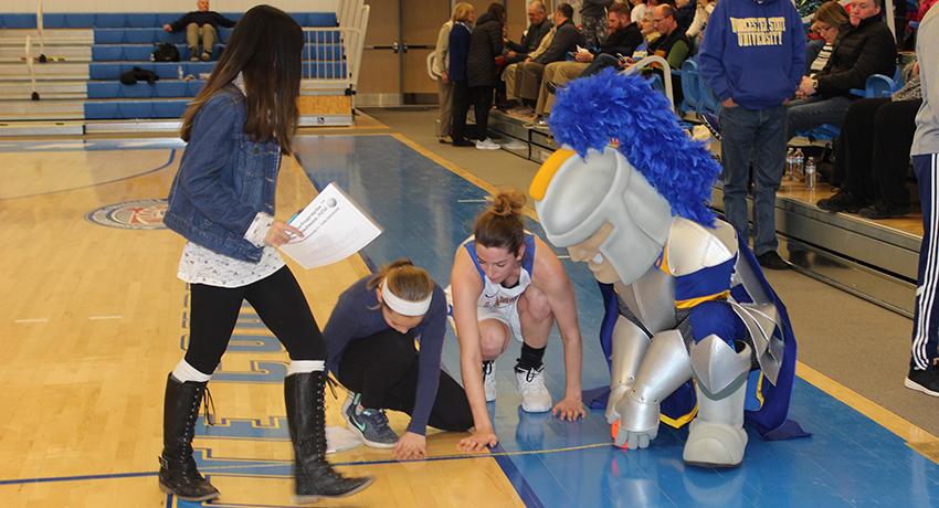 Worcester State mascot helps Worcester schoolchildren measure basketball court.