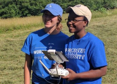 Worcester State students Farah Aubin Lauryn Mulcahy operating a drone