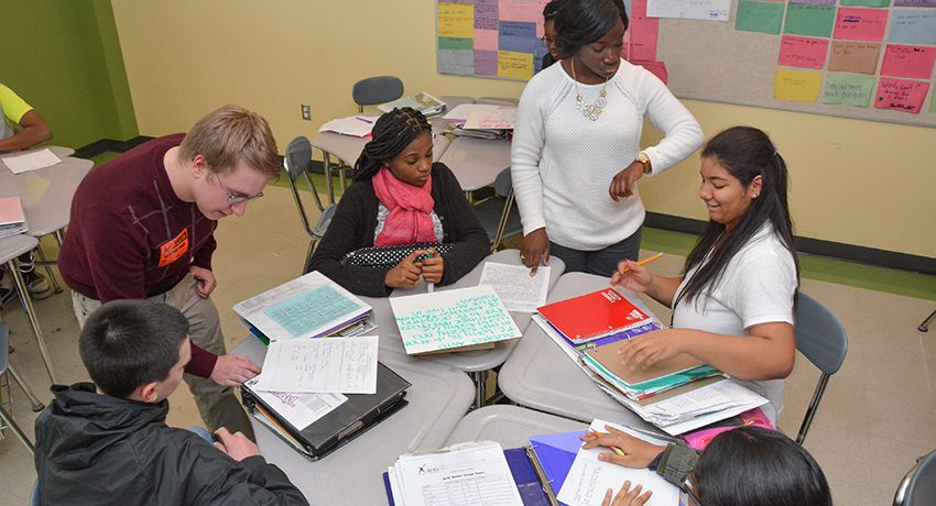 Students, teachers, and a volunteer in a Worcester public high school