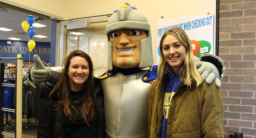 WSU students Sarah Deslauriers (left) and Anna Billings with WSU mascot Chandler at the ribbon cutting for the newly renovated campus bookstore.
