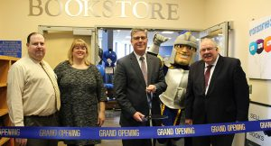 Attending the ribbon cutting for the renovated WSU bookstore are (from left) Sean Cook, bookstore manager; Julie Kazarian, dean of students; President Maloney; and David Klein of Follett.