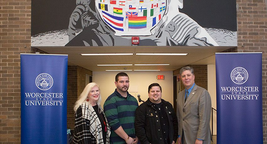 Mural artists Louise McGee, Danial Acuna, Bradley Chapman, with President Barry Maloney