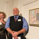 WSU student Colin Plante with Juliet Feibel, ArtsWorcester executive director. Colin's watercolor is also visible.
