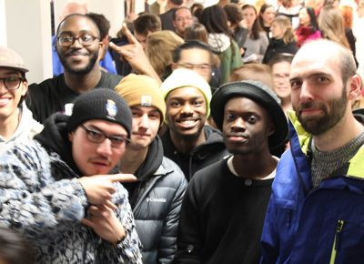Eric Nichols (far right) with a group of his photography students at the ArtsWorcester opening to support student George Annan, whose work was juried in to the show