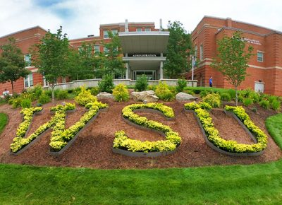 Worcester State University shrubbery letters behind Shaughnessy administration building