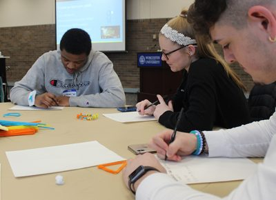 Students work on solving problems at WooMagine