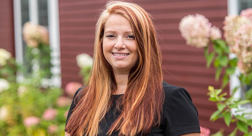 Kat Stevens smiles at the camera.